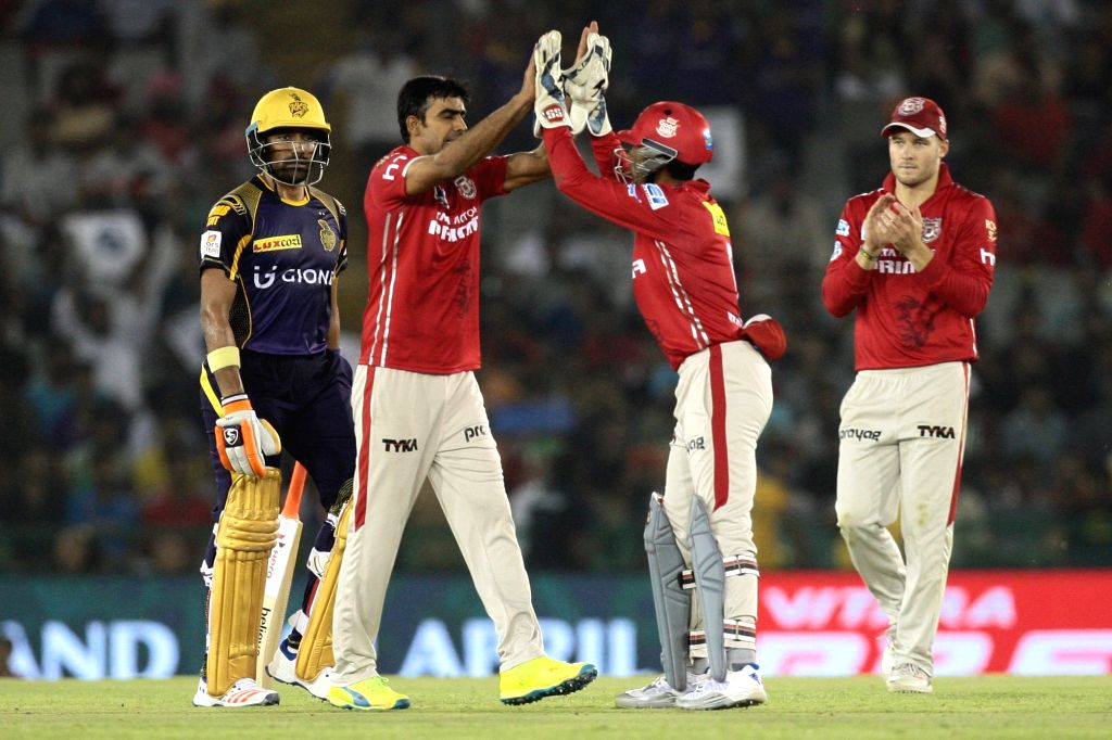 Kings XI Punjab celebrate fall of a wicket during an IPL match between Kings XI Punjab and Kolkata Knight Riders at Punjab Cricket Association IS Bindra Stadium in Mohali on April 19, 2016.