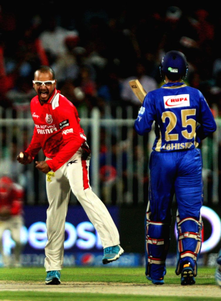 Kings XI Punjab player Murali Kartik celebrates fall of a wicket during the seventh match of IPL 2014 between Rajasthan Royals and Kings XI Punjab, played at Sharjah Cricket Stadium in Sharjah of ...