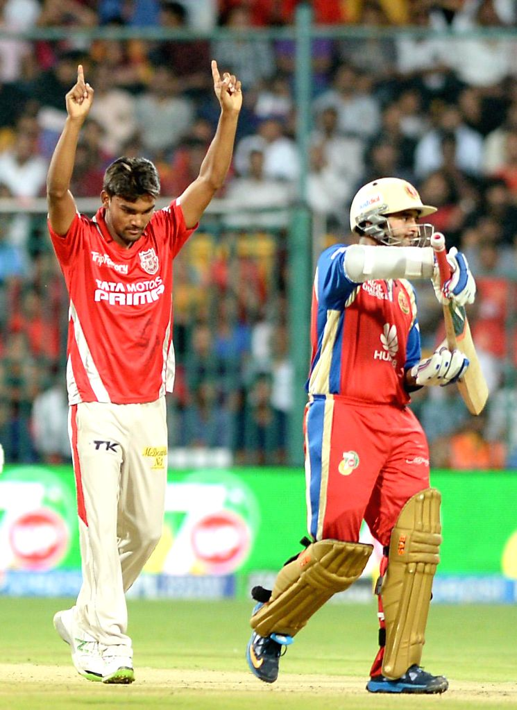 Kings XI Punjab player Sandeep Sharma celebrates fall of a wicket during the 31st match of IPL 2014 between Kings XI Punjab and Royal Challengers Bangalore at  M Chinnaswamy Stadium in Bangalore on .. - Sandeep Sharma