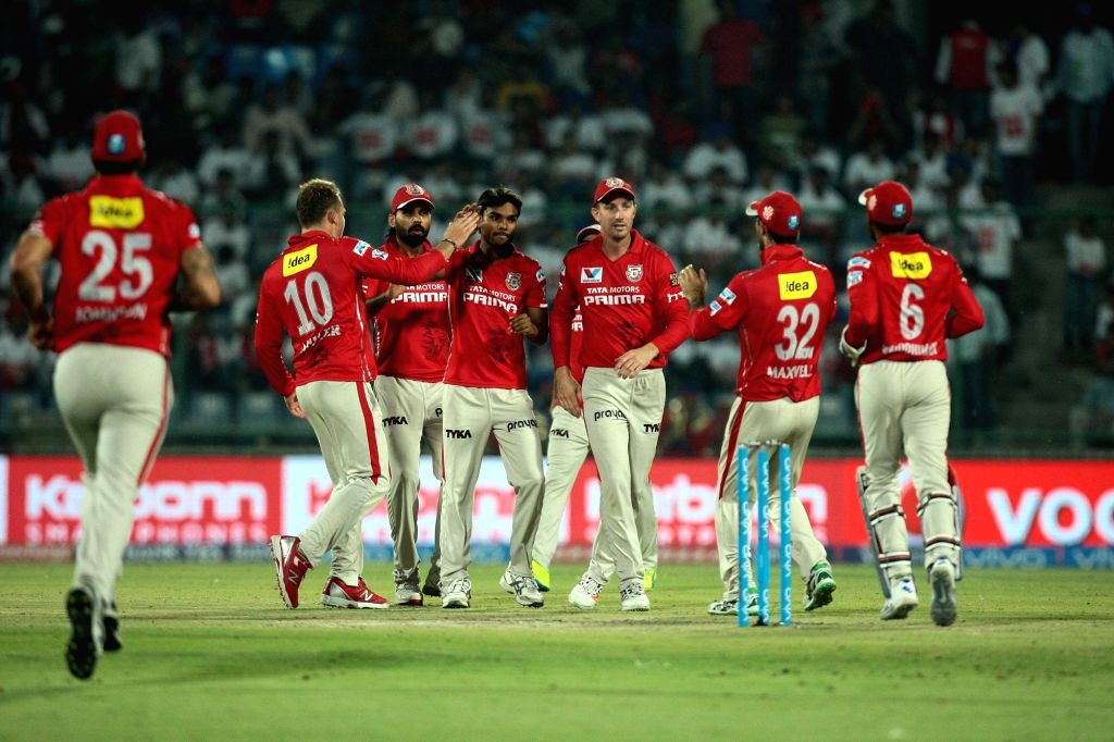 Kings XI Punjab players celebrate fall of a wicket during an IPL match between Delhi Daredevils and Kings XI Punjab at Feroz Shah Kotla Stadium in New Delhi on April 15, 2016.