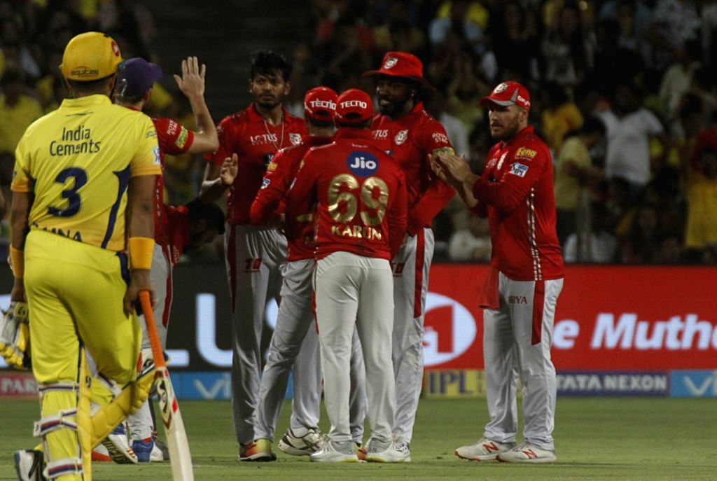 Kings XI Punjab players celebrate fall of a wicket during an IPL 2018 match between Chennai Super Kings and Kings XI Punjab at Maharashtra Cricket Association Stadium in Pune on May 20, 2018.