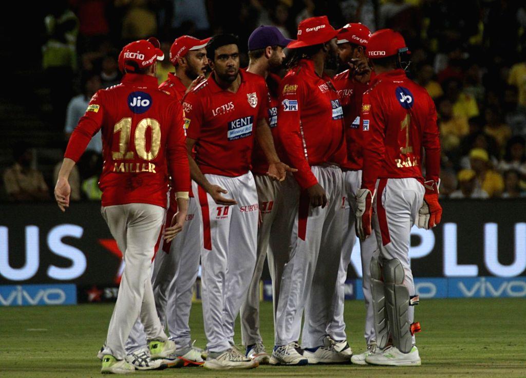 Kings XI Punjab players celebrate fall of Deepak Chahar's wicket during an IPL 2018 match between Chennai Super Kings and Kings XI Punjab at Maharashtra Cricket Association Stadium in Pune on ...
