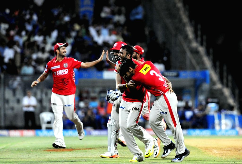 Kings XI Punjab players celebrates fall of a wicket in action during an IPL 2017 match between Mumbai Indians and Kings XI Punjab at Wankhede Stadium in Mumbai on May 11, 2017.