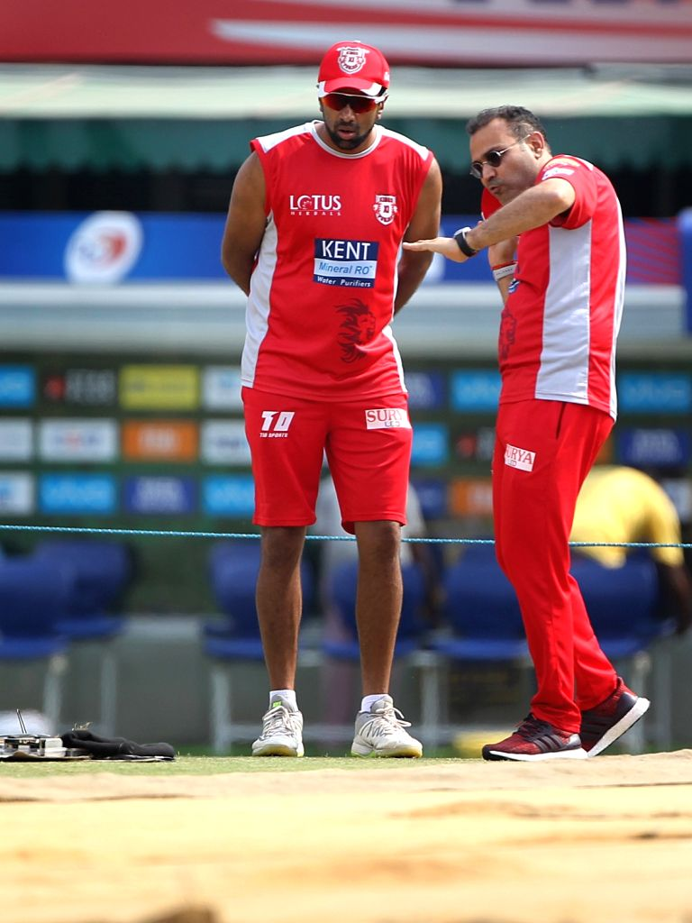 Kings XI Punjab skipper Ravichandran Ashwin and mentor Virender Sehwag during a practice session in Mohali on April 7, 2018.