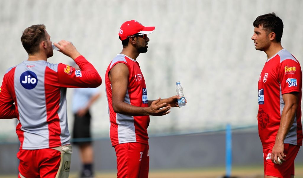 Kings XI Punjab skipper Ravichandran Ashwin (C) during a practice session in Mohali on April 7, 2018.