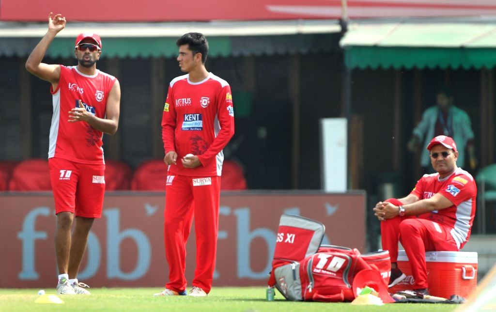 Kings XI Punjab skipper Ravichandran Ashwin (L) during a practice session in Mohali on April 7, 2018.
