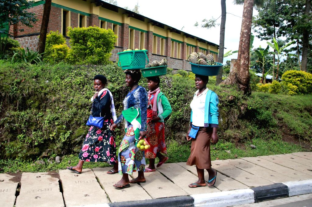 KINIGI (RWANDA), Oct. 7, 2019 People walk on the road in Kinigi sector of Musanze District, northern Rwanda, on Oct. 7, 2019. Rwandan police said the situation has been normalized ...