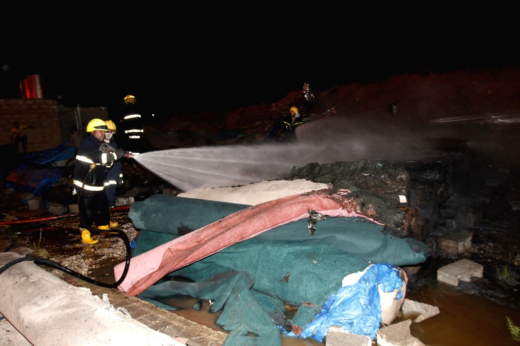 Firefighters work at the site of a car bomb attack in the northern Iraqi city of Kirkuk April 24, 2014. A total of 25 people were killed and 35 others wounded in ...