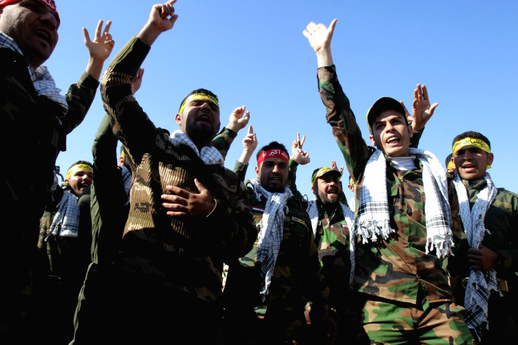 Government-backed Sunni Arab tribesmen from paramilitary groups are reviewed at the end of their training period to fight Islamic State (IS) militants in the Kirkuk, ...