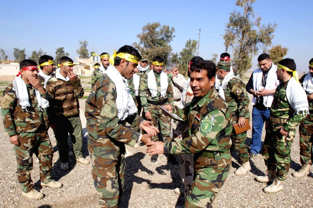 Government-backed Sunni Arab tribesmen from paramilitary groups demonstrate their skills at the end of their training period to fight Islamic State (IS) militants in ...