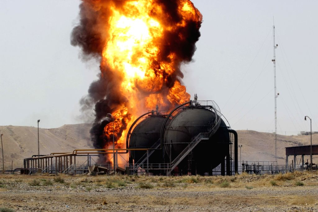 KIRKUK,Huge fire rises from a fuel tank after gunmen stormed the oil field of Bai Hassan in northwest of the city of Kirkuk, Iraq, on July 31, 2016. Gunmen attacked ... - Hassan
