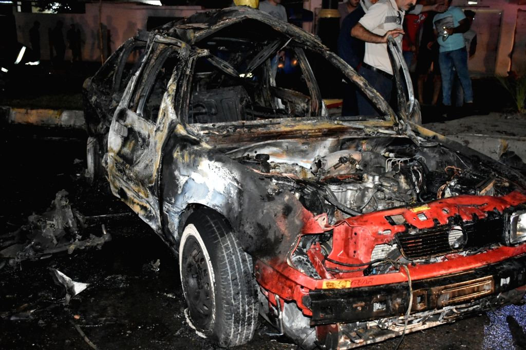 KIRKUK (IRAQ), Sept. 16, 2017 A destroyed car is seen at the site of a car bomb explosion in the city of Kirkuk, Iraq, Sept. 16, 2017. Three people were killed and nine others wounded on ...