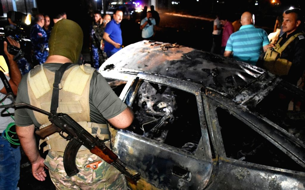 KIRKUK (IRAQ), Sept. 16, 2017 Security personnel check a destroyed car at the site of a car bomb explosion in the city of Kirkuk, Iraq, Sept. 16, 2017. Three people were killed and nine ...