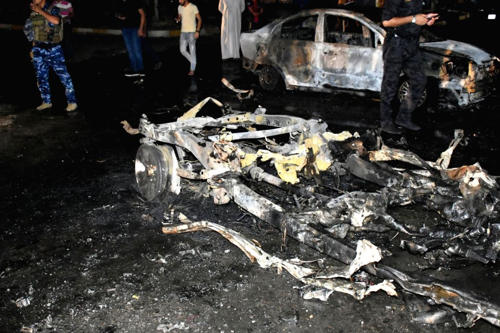 KIRKUK (IRAQ), Sept. 16, 2017 The wreckage of a destroyed car is seen at the site of a car bomb explosion in the city of Kirkuk, Iraq, Sept. 16, 2017. Three people were killed and nine ...