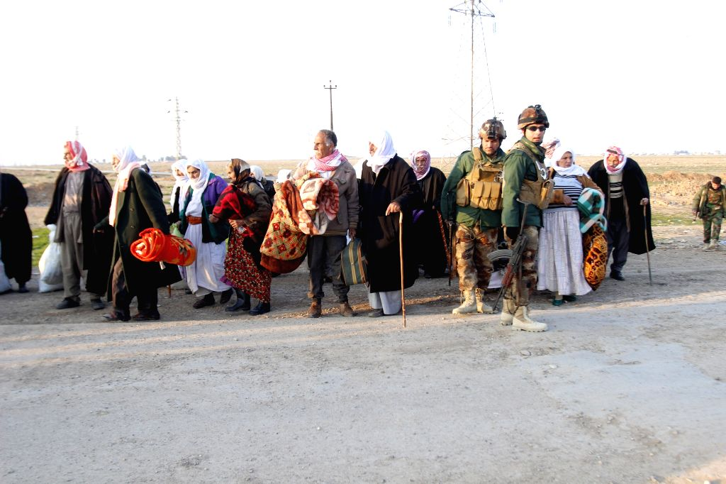 A group of Yazidi civilians who were released by Islamic State militants look on, waiting for assistance in the southwest of Kirkuk, northern Iraq, Jan. 17, 2015. ...