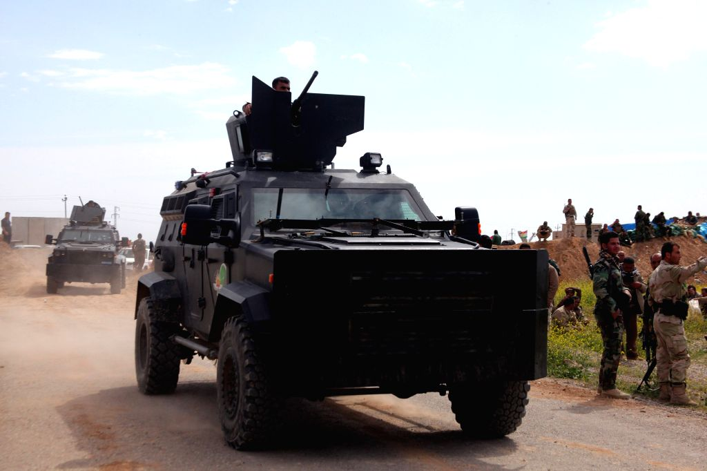 A convoy of armored vehicle of Kurdish security forces is seen near Kirkuk, north Iraq, on March 16, 2015. Kurdish fighters on Monday recaptured three villages near ...
