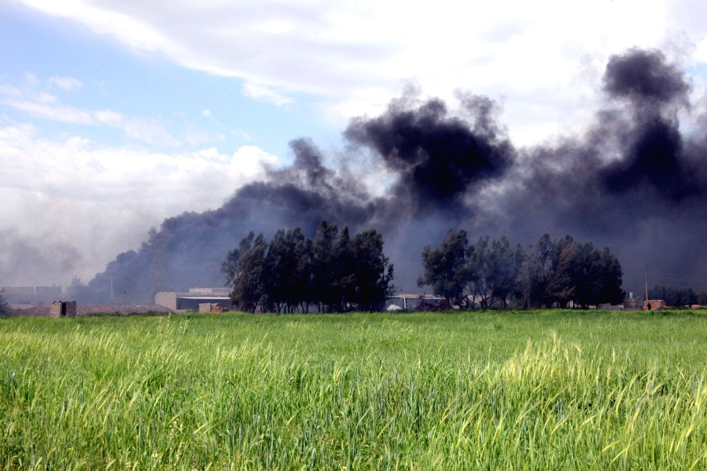 Heavy smoke rises after Kurdish security forces, known as Peshmerga, cleared three villages near Kirkuk, north Iraq, on March 16, 2015. Kurdish fighters on Monday ...