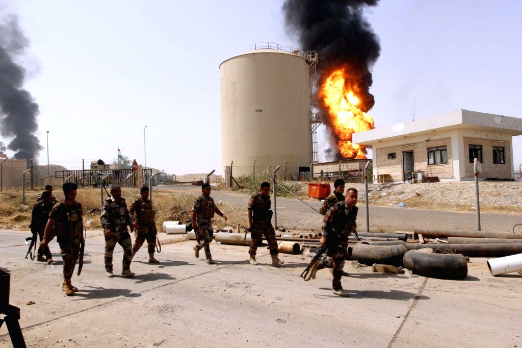 KIRKUK,Security forces arrive at the site after gunmen stormed the oil field of Bai Hassan in northwest of the city of Kirkuk, Iraq, on July 31, 2016. Gunmen attacked ... - Hassan