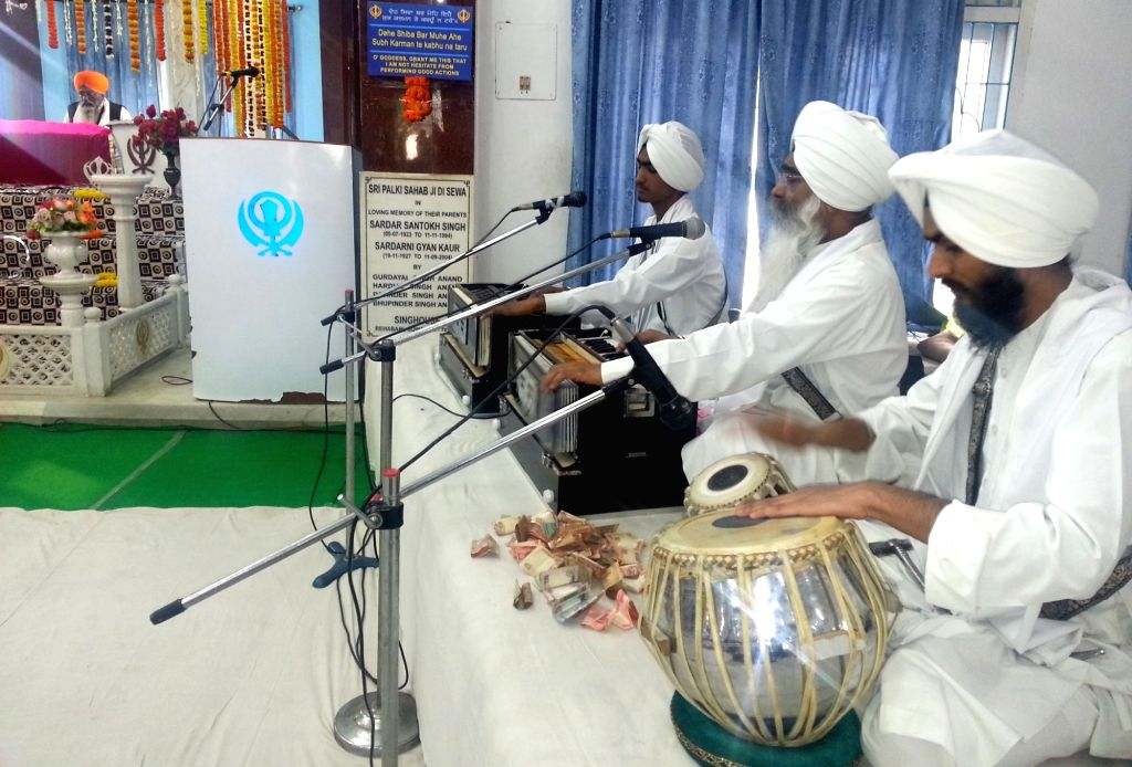 Kirtan at Gurduwara Sri Guru Singh Sabha, Gopinath Nagar on the occasion of birth anniversary celebration of the 10th Sikh Guru Gobind Singh in Guwahati, on Jan 16, 2016.