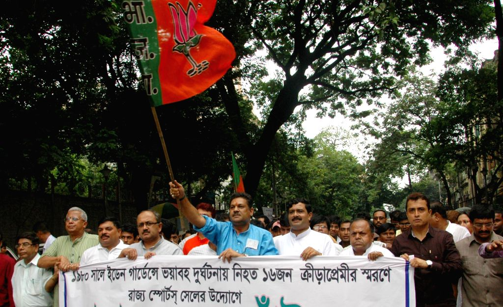 Kirti Azad, MP, Sidharth Nath Singh, central observer of BJP in West Bengal, West Bengal BJP chief Rahul Sinha and others during West Bengal state BJP organized ``Walk for Sports`` in Kolkata on Aug . - Sidharth Nath Singh and Rahul Sinha