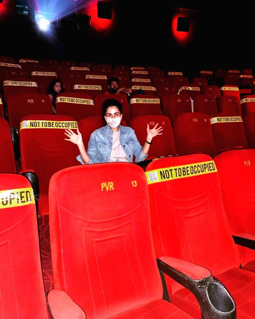 Kirti Kulhari watches film on big screen as mark of support to cinema halls.
