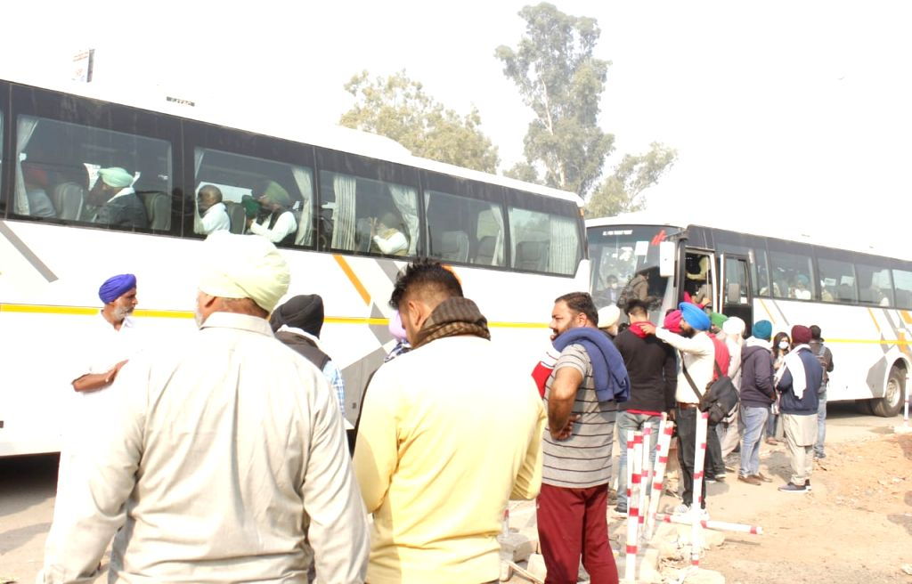 Kisaan unions leader going by Bus  to Vigyan Bhawan for meeting with Rajnath Singh with others BJP manister in New Delhi on Thursday. - Rajnath Singh