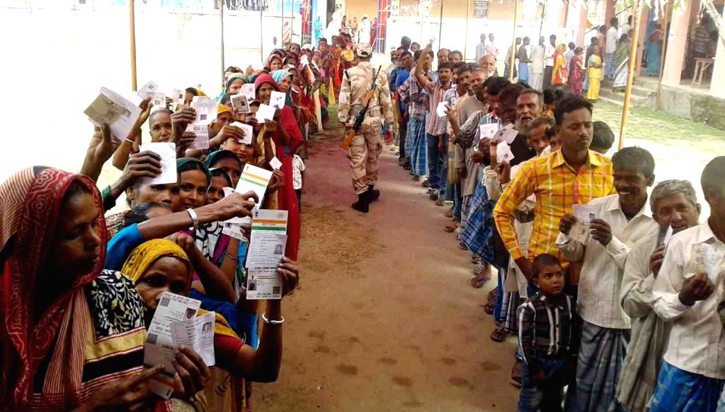 :Kishanganj: People queue-up to cast their votes at a polling booth during the final phase of Bihar assembly polls in Kishanganj district of Bihar on Nov. 5, 2015. (Photo: IANS).