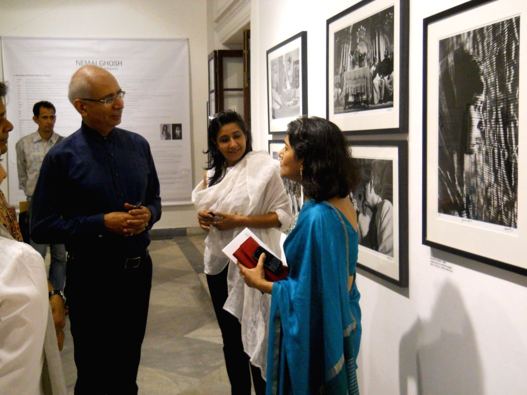 Kishore Singh of Delhi Art Gallery at the exhibition of Photographer Nemai Ghosh's Satyajit Ray and Beyond presented by the Delhi Art Gallery in Kolkata on August 16, 2013. Nemai Ghosh is best .. - Kishore Singh