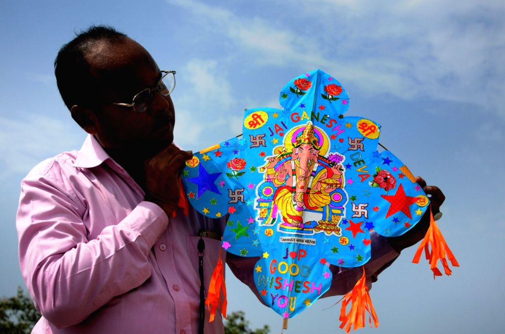 Kite-maker Jagmohan Kanojia shows a kite with a picture of Lord Ganesha, specially designed on the occasion of Ganesh Chaturthi, in Amritsar on Sept 15, 2018.