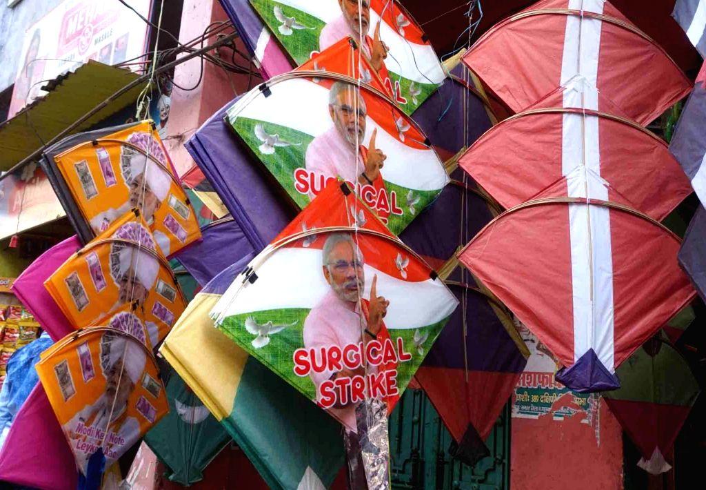 "Kites bearing Prime Minister Narendra Modi's picture and reading ""Surgical Strike"" being sold ahead of Makar Sankranti in Varanasi, on Jan 13, 2017. - Narendra Modi"