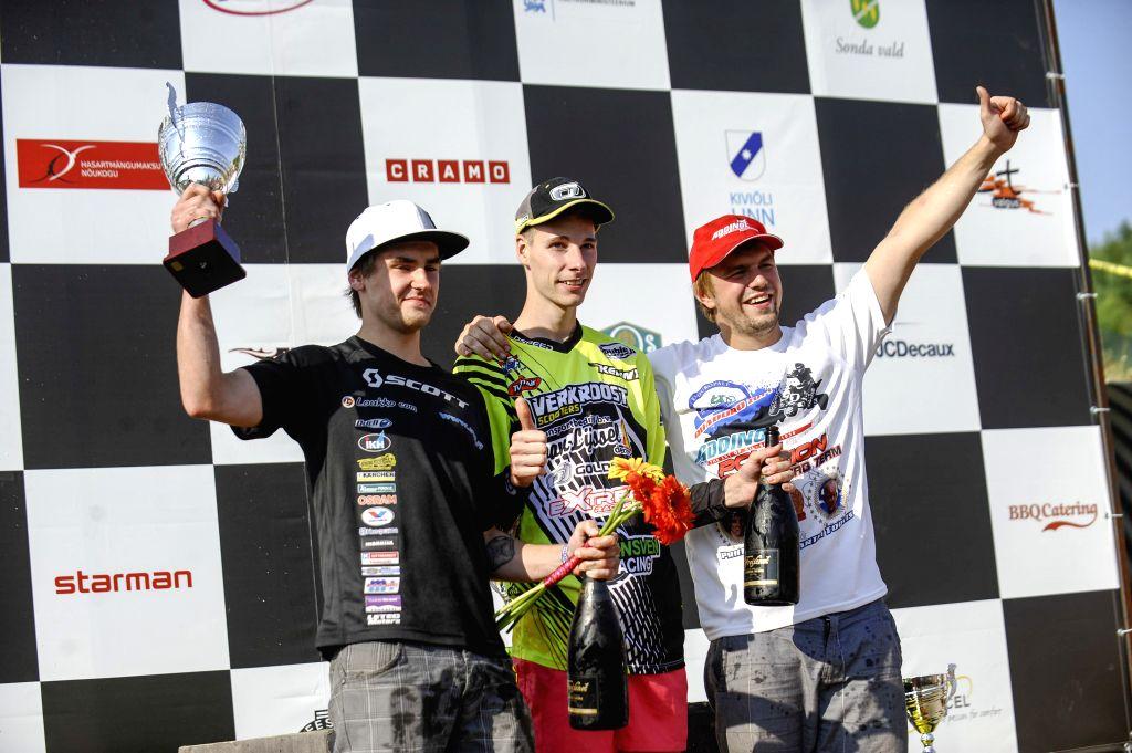 First-place-winner Mike Van Grinsven (C) of the Netherlands, second-place-winner Olli Koskela (L) of Finland and third-place-winner Henri Mundi of Estonia celebrate .