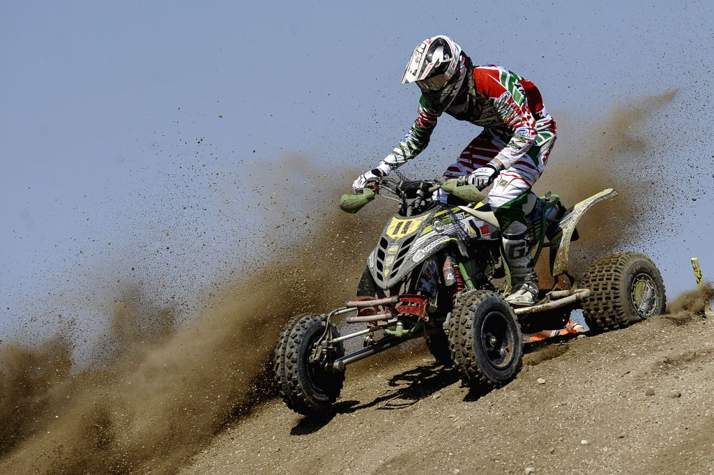 Mike Van Grinsven of Netherlands competes during the MAXXIS Quadcross European Championship held in Kivioli, Estonia on August 3, 2014. (Xinhua Photo/Sergei ...