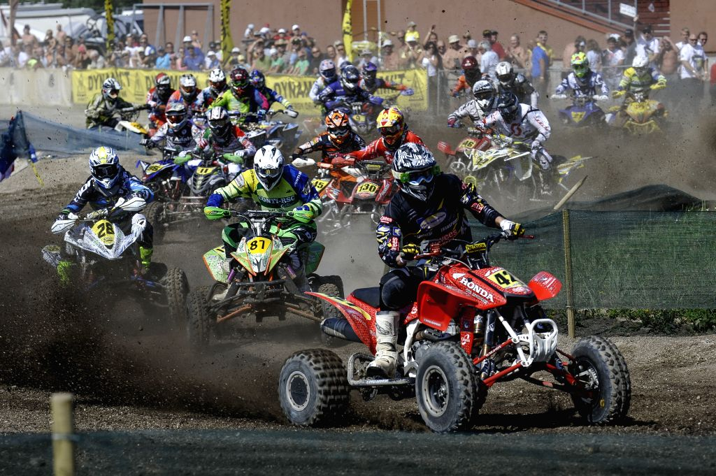 Riders compete during the MAXXIS Quadcross European Championship held in Kivioli, Estonia on August 3, 2014.