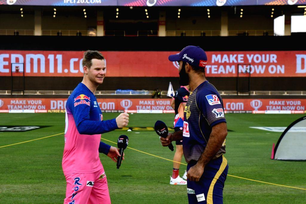 KKR Captain Dinesh Karthik, Rajasthan Royals Captain Steve Smith, Match Referee Narayana Kutty and Commentator Mark Nichols ahead of match 12 of season 13, Dream 11 Indian Premier League (IPL) ... - Dinesh Karthik