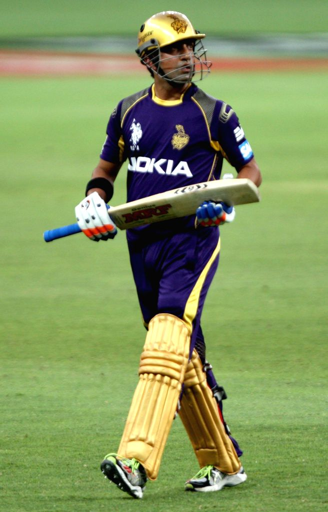 KKR player Gautam Gambhir walks back to the pavilion after dismissed for a duck during the sixth match of IPL 2014 between Delhi Daredevils and Kolkata Knight Riders, played at Dubai International ...