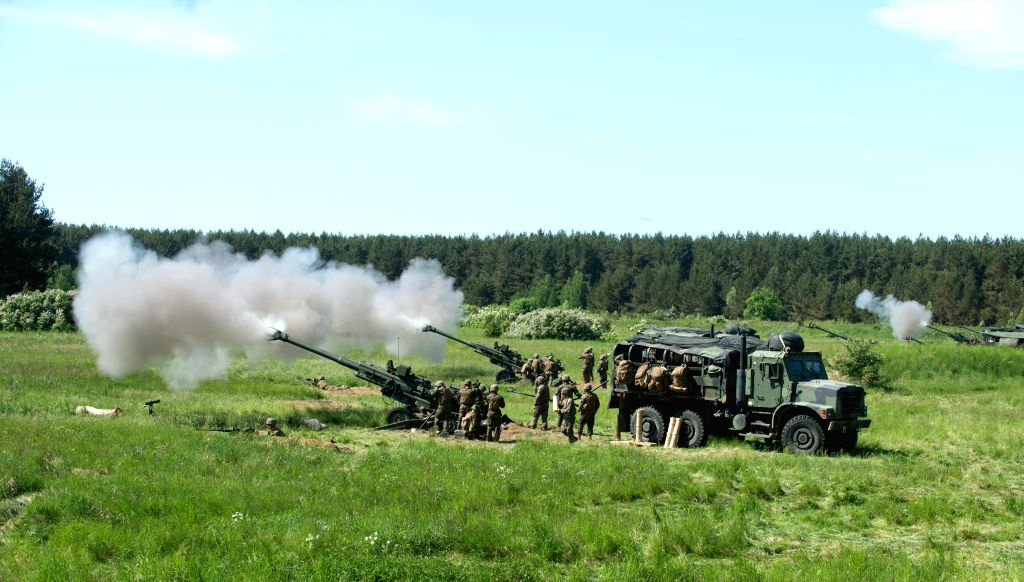 "KLAIPEDA DISTRICT (LITHUANIA), May 23, 2018 Photo taken on May 23, 2018 shows a scene of a media day training of the ""Flaming Thunder 2018"" international artillery drill in ..."