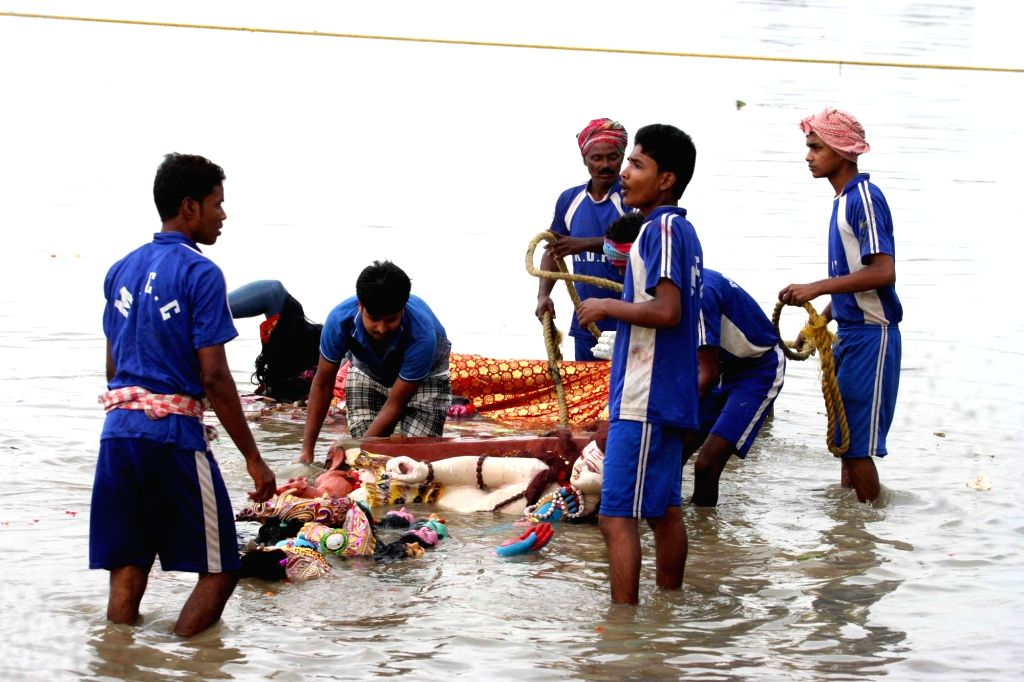 KMC workers clean Babu Ghat after immersion of goddess Kali at Ganga river in Kolkata on Oct 31, 2016.