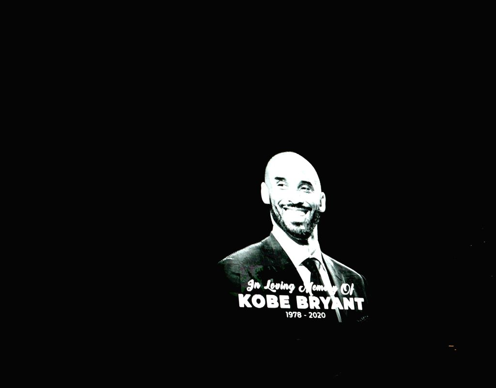 Kobe Bryant's portrait is displayed outside the Staples Center to pay respects to Kobe Bryant, in Los Angeles, California, the United States, on Jan. 26, 2020. ...