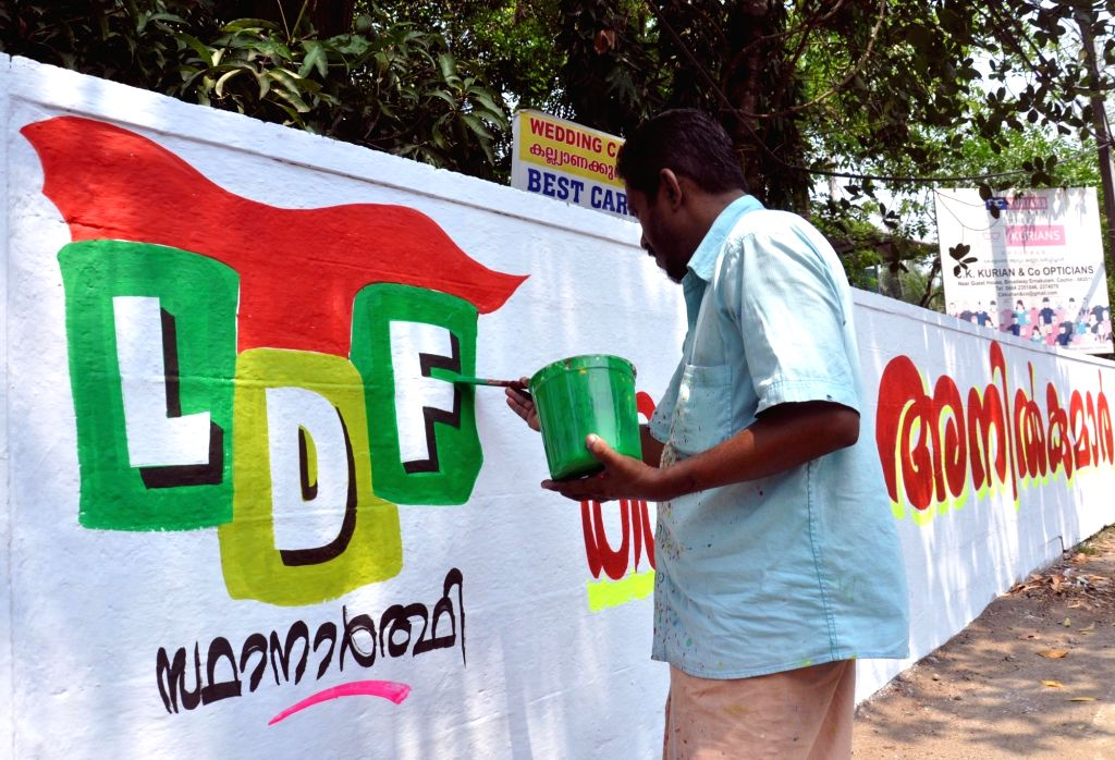 Kochi: An artist makes graffiti of Left Democratic Front (LDF) in Kochi ahead of Kerala assembly polls. (Photo: IANS)