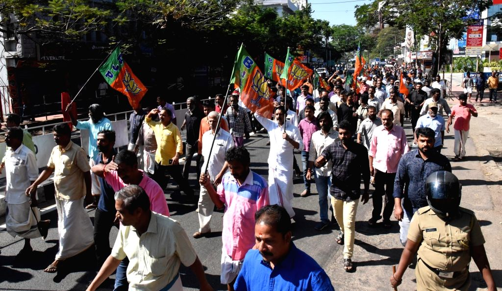 Kochi: BJP workers stage a demonstration during a dawn-to-dusk Kerala shutdown called by the Sabarimala Karma Samithi (SKS) to protest against the visit of two women in the hitherto banned age group who entered the Sabarimala temple before dawn and o