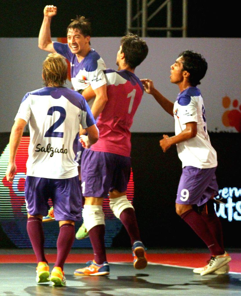 Kochi's players celebrate during a Premier Futsal match between Kochi and Chennai; in Chennai on July 17, 2016.