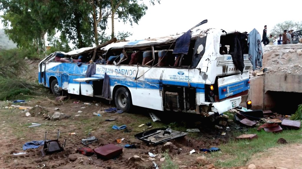 KOHAT (PAKISTAN), Aug. 4, 2018 A damaged passenger bus is seen on the site of an accident in Pakistan's northwestern district of Kohat, on Aug. 4, 2018. At least 14 people were killed and ...
