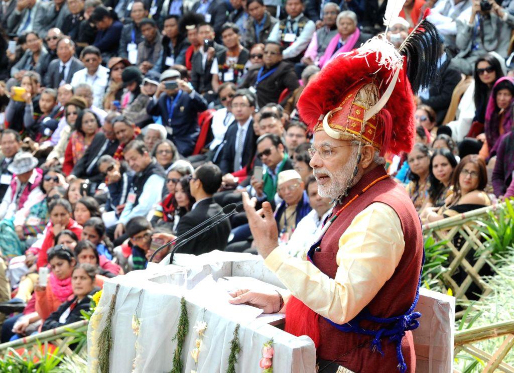 Kohima: Prime Minister Narendra Modi addresses at the Hornbill Festival, in Kohima, Nagaland on Dec 1, 2014. (Photo: IANS/PIB) - Narendra Modi