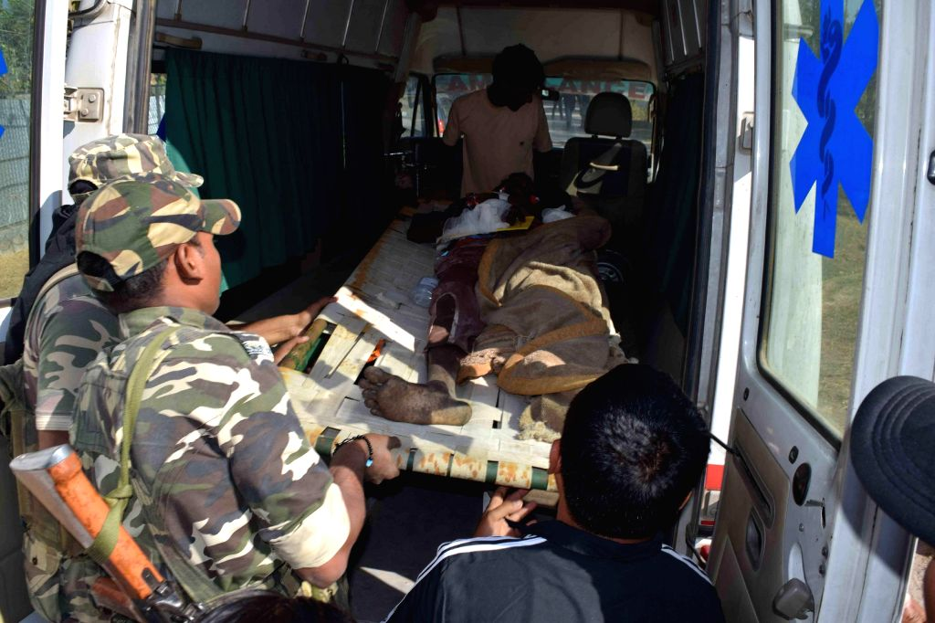 Bodies of the villagers killed in a raid carried out by Bodo militants in  Kokrajhar village being removed on Dec 24, 2014.