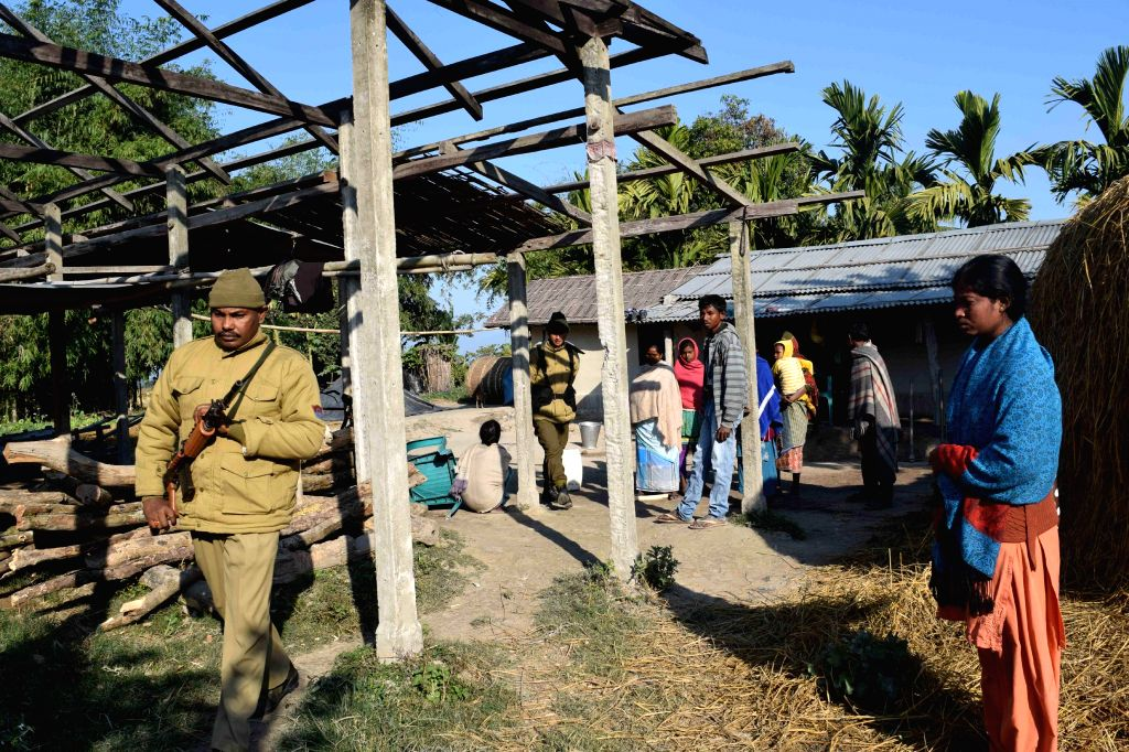 People at a village in Assam's Kokrajhar district that was raided on Tuesday (23rd December) by Bodo militants, on Dec 24, 2014.