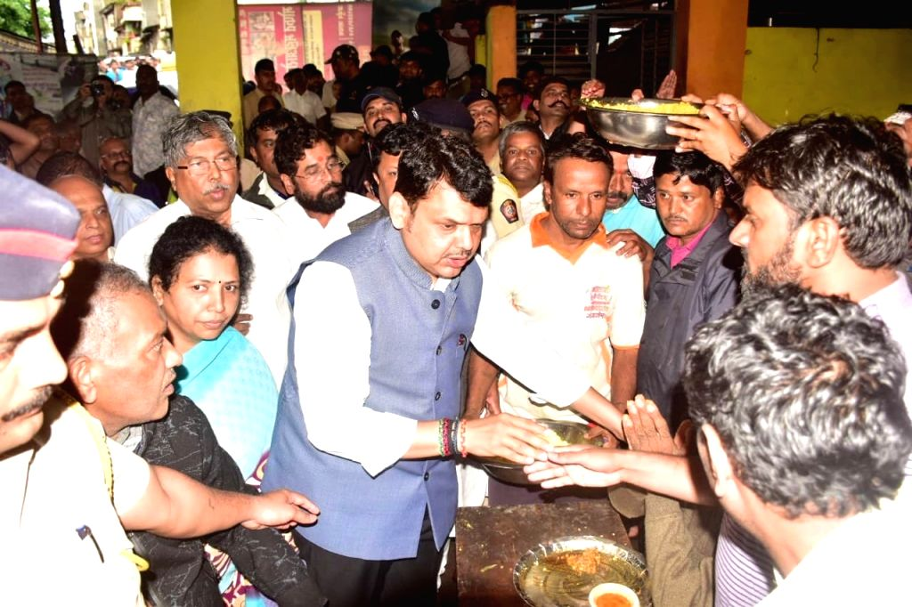 Kolhapur: Maharashtra Chief Minister Devendra Fadnavis meets flood victims at a relief camp set up at Chhatrapati Shahu Vidyalaya in flood affected Kolhapur, on Aug 8, 2019. (Photo: IANS) - Devendra Fadnavis