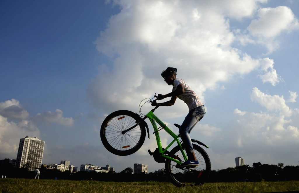 Kolkata : A boy is doing a bicycle stunt at Maidan in Kolkata on Tuesday April 13th, 2021.
