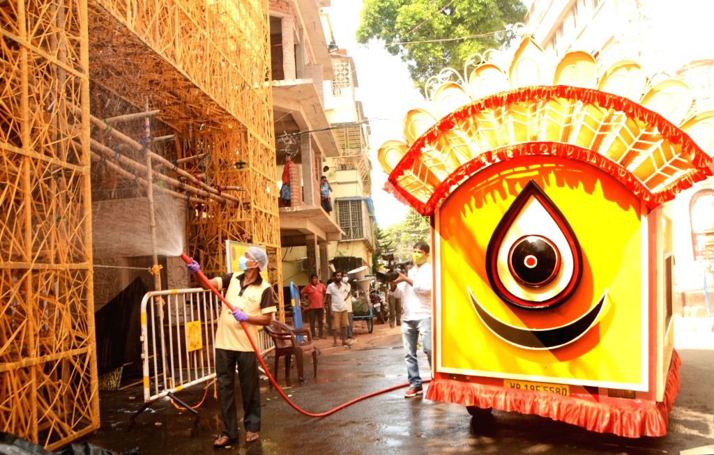 Kolkata : A community puja pandal sanitized which was under preparation ahead of Durga Puja festival amid coronavirus pandemic in Kolkata on October 11, 2020.