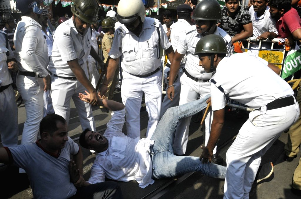 Kolkata: A Congress activist being detained during a demonstration against the Trinamool Congress-led state government over 'cut money', outside Lal Bazar Police headquarters in Kolkata on July 17, 2019. (Photo: IANS)