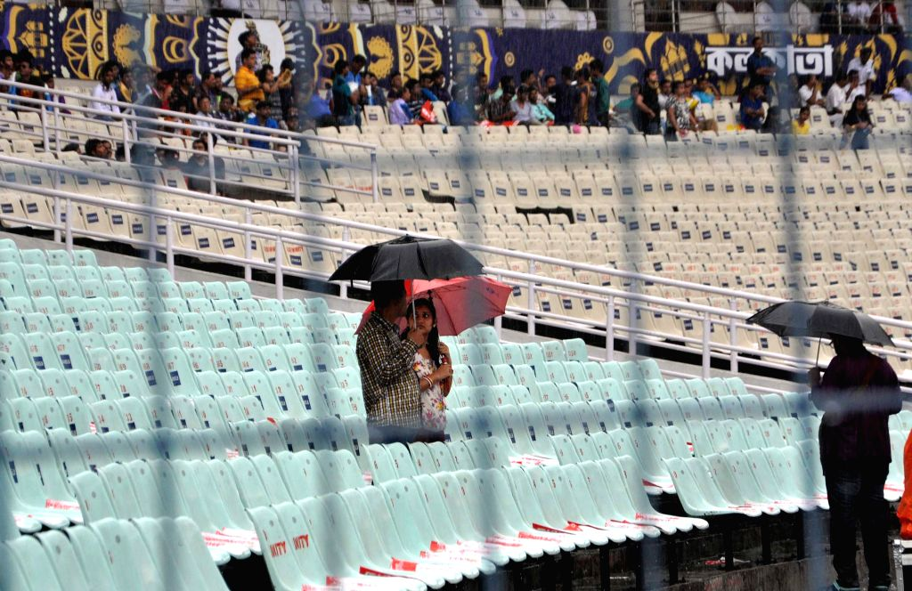 A couple in the empty stands of the Eden Garden where rains disrupted an IPL-2015 match between Kolkata Knight Riders (KKR) and Rajasthan Royals (RR) in Kolkata on April 26, 2015.